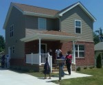 Attendees of the July 12 ribbon-cutting ceremony tour one of the five new Market Street Homes on Madison, IL.