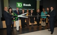 Ribbon cutting ceremony at the opening of the newest TD Bank branch at 49th Street and Second Avenue in New York, NY: (left to right): Zev Araradian (Store Mgr, TD); Elena Sarkissian (Chair of Board, FAR); Assemblyman Jonathan Bing; Margaret Minson (Student Sponsor Partners); Richelle Price (NDC); Irina Zaslavskya (Grand Central); Lee Stergiou (Grand Central); Gertrude Scriven (NDC); Melissa Hays (Assistant Store Mgr, TD); Joe Paradise (TD)