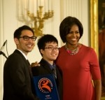 YouthCAN coordinator Joshua Heim, participant and Garfield High School student King Lau, and First Lady Michelle Obama in the White House East Room.